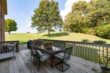 Back deck, very private with tree lined property line