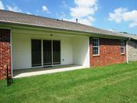 The covered back porch lends itself to privacy with lots of room behind the home.