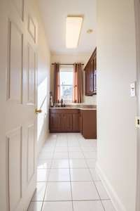 Great utility room with nice sink and cabinetry