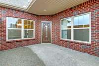Courtyard patio is private. Photo is NOT of actual home and finishes will vary.