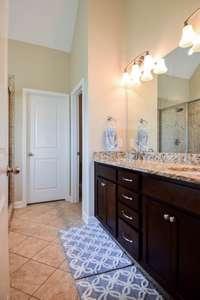 Fantastic full bath, water closet, double vanities walk-in closet,