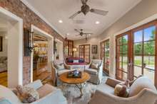 Sun Room right off the family room with direct access to pool area allows cool afternoons while enjoying those who are spending time in the pool