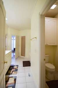 Large full bath off owner's suite and office