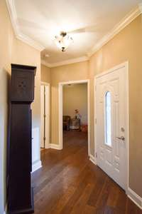As you enter from the courtyard, gleaming hardwood floors