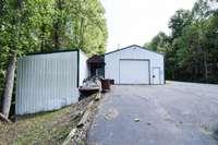 Huge detached garage/workshop and attached office with half bath