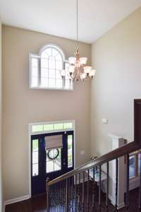 View of the foyer as you go to the upper level