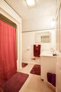 Lovely full bath with shower/tub combo on the upper level