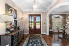 Enter the foyer to warm and inviting estate living