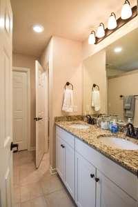 Water closet, double vanities