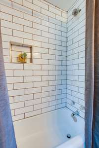 Newly tiled shower surround... so sleek and stylish!