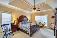 Welcoming Primary suite with tray ceiling, lots of light and very spacious.