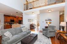 Open floorplan including catwalk with Wrought Iron Balusters
