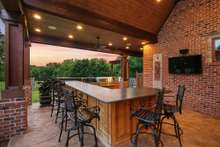 This bar/grilling area allows for plenty of space for entertaining family and friends