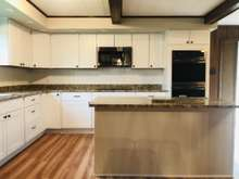 Shaker Cabinets, granite countertops and SS appliances