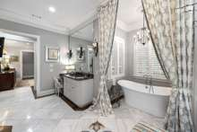 No detail missed in this amazing Master Bath with Carrera Marble floors and elegant lighting.