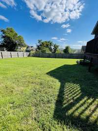 huge backyard with a privacy fence