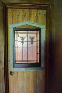Lovely stained glass door to upper level full bath