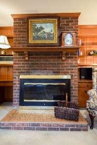 Handsome fireplace in den