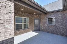 Your private courtyard leading into your home. This photo is NOT the actual home. Finishes will be different.