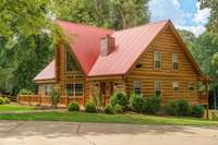 Magnificent log home on 9.96 beautiful acres