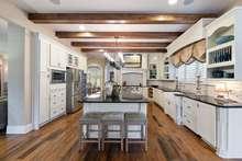 Elegant lighting and custom finishes make this kitchen shine