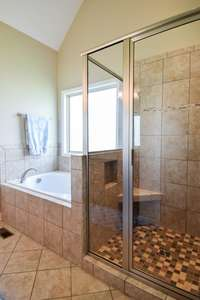 Large tile shower and separate tub
