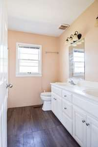 Lovely full bath with double vanities, shower/tub combo