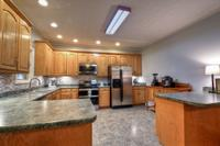 Stainless steel appliances and lots of cabinetry.