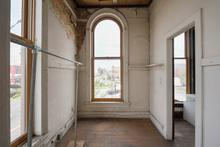 Take a look at these beautiful arched windows that showcase a view of Lebanon's historic square. Windows were replaced by current owners in 2002.