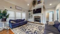 Large open family room with built-in bookcase gas fireplace and recessed lighting