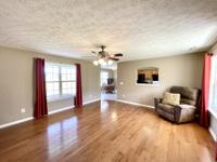 Hardwood floors in living area.