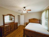 Hardwood floors in main bedroom.