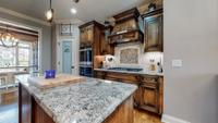Lots of counter space, cabinets, and double ovens