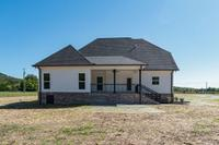 Photos are of another home built by Tim Tomlinson Homes w/ the same floor plan - Finishes May Vary