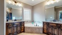 Master suite bath on main level with dual vanities