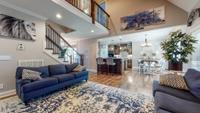 Family room open to 2nd level with high ceilings