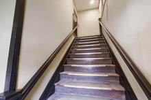 Entrance to stairway leading to upper level located on West Main St side of building.