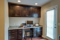 Custom built in work space with granite top and lots of cabinet and drawer space.