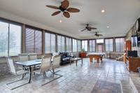 800 sq. ft. tiled sun room with ceiling fans.