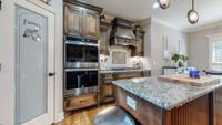 Spacious pantry with frosted glass door