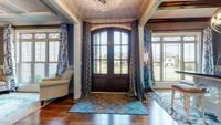 Stunning foyer with lots of natural lighting and hardwood floors