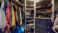 """Custom """"hers"""" closet with built-ins, shoe carousel and make-up vanity"""
