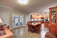 Large dining area opens up to kitchen and leads down into sun room.