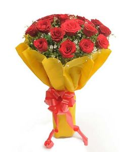 20 Red Roses in Yellow Paper Packing