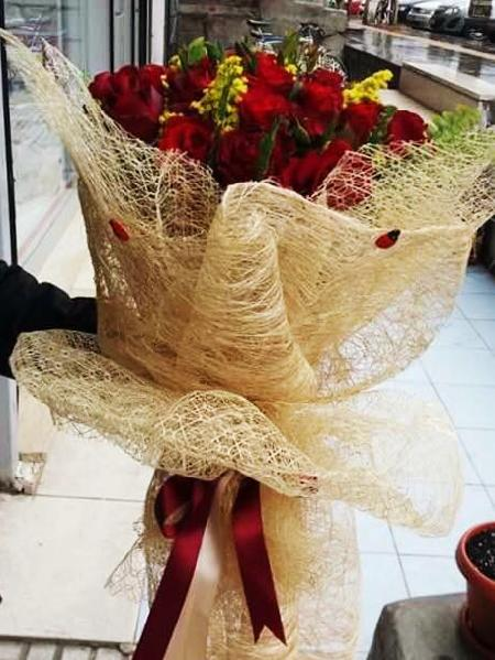 Jute Wrapped Bunch of 24 Red Roses