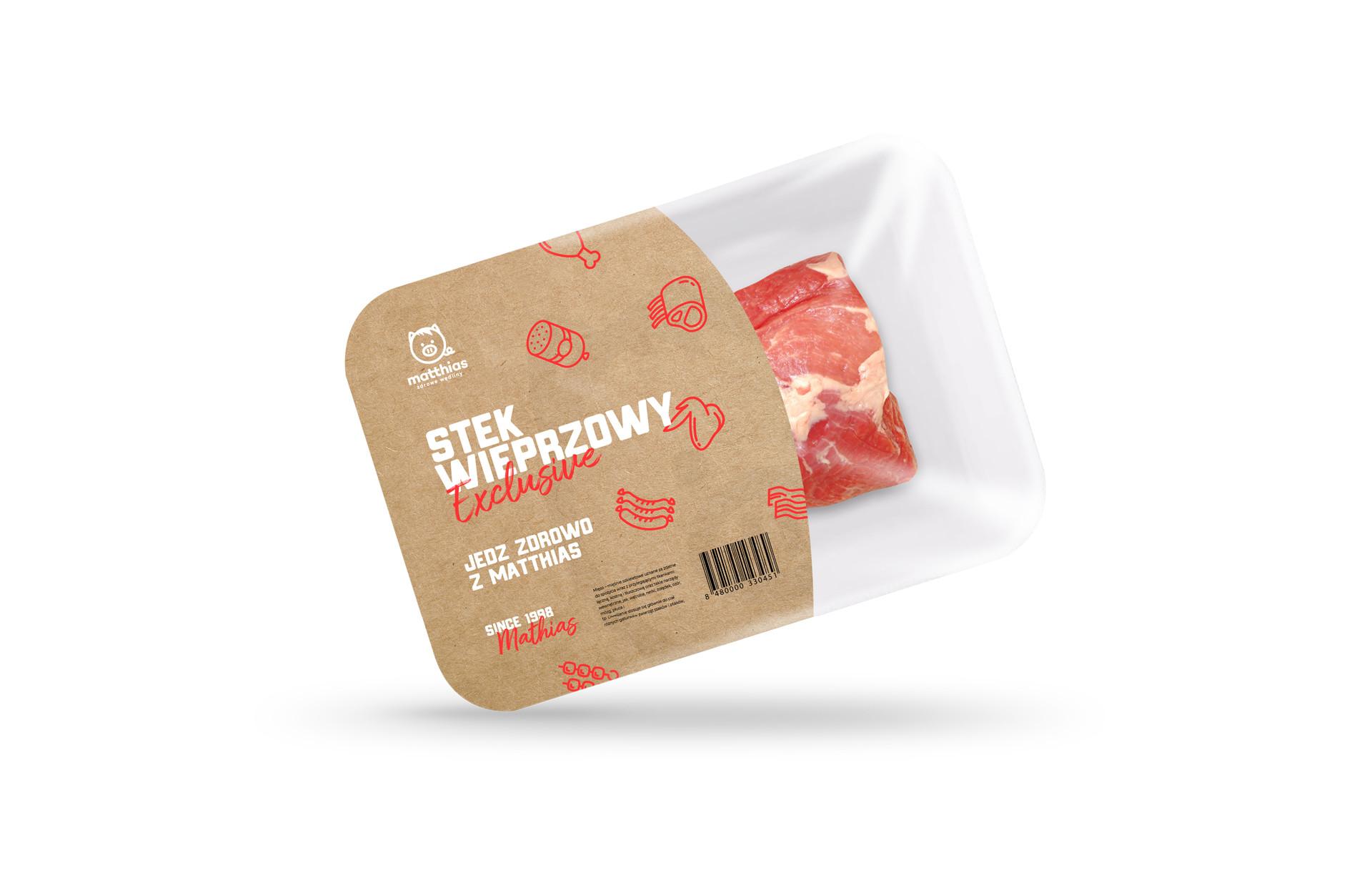Stek wieprzowy w opakowaniu na białym tle