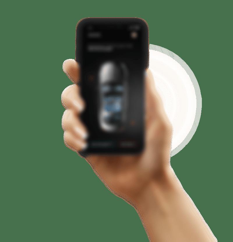 Szara grafika przedstawiająca rękę trzymającą telefon