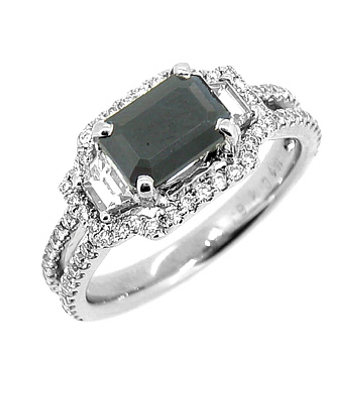 Dark sapphire and diamond cluster ringPictured item: sapphire: total 1.00ct/diamonds: total 0.78ct set in 18k white gold