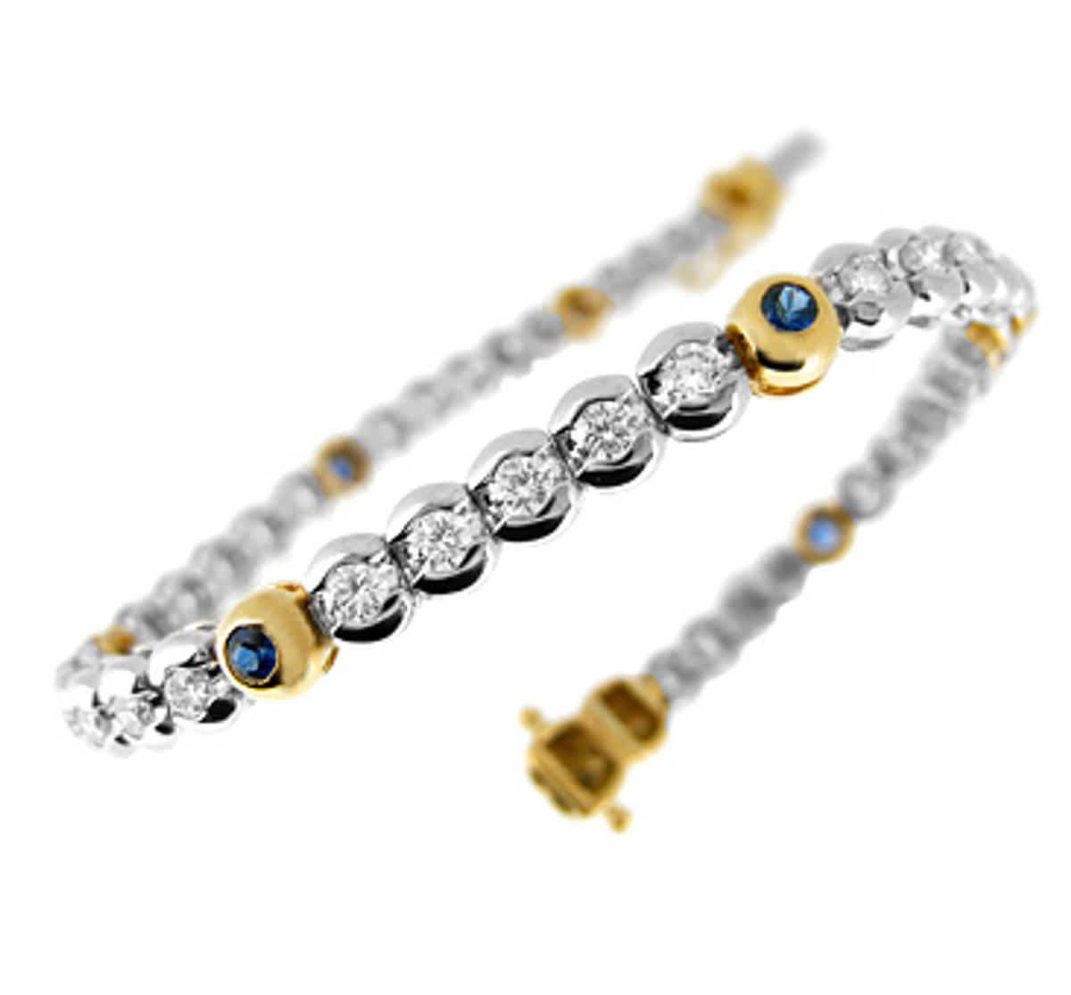Sapphire diamond rubover set line braceletAvailable in: 18k goldPictured item: 0.70ct sapphire/2.42ct brilliant cut diamond set in 18k yellow/white gold