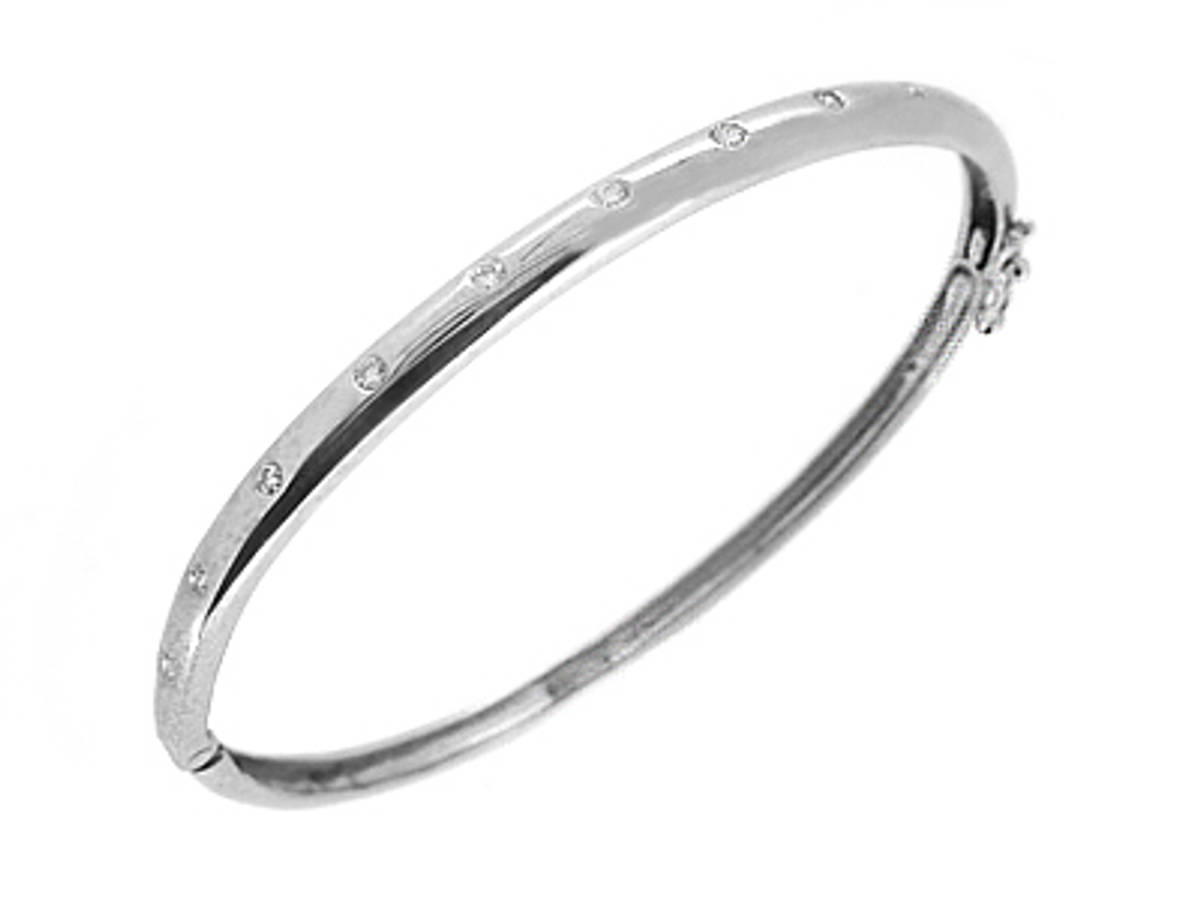 9k white gold brilliant cut diamond bangle Total diamond weight 0.26cts ONE SIZEMade in Ireland